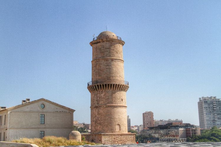 Low Angle View Of Tour Du Fanal At Fort Saint Jean Against Clear Sky