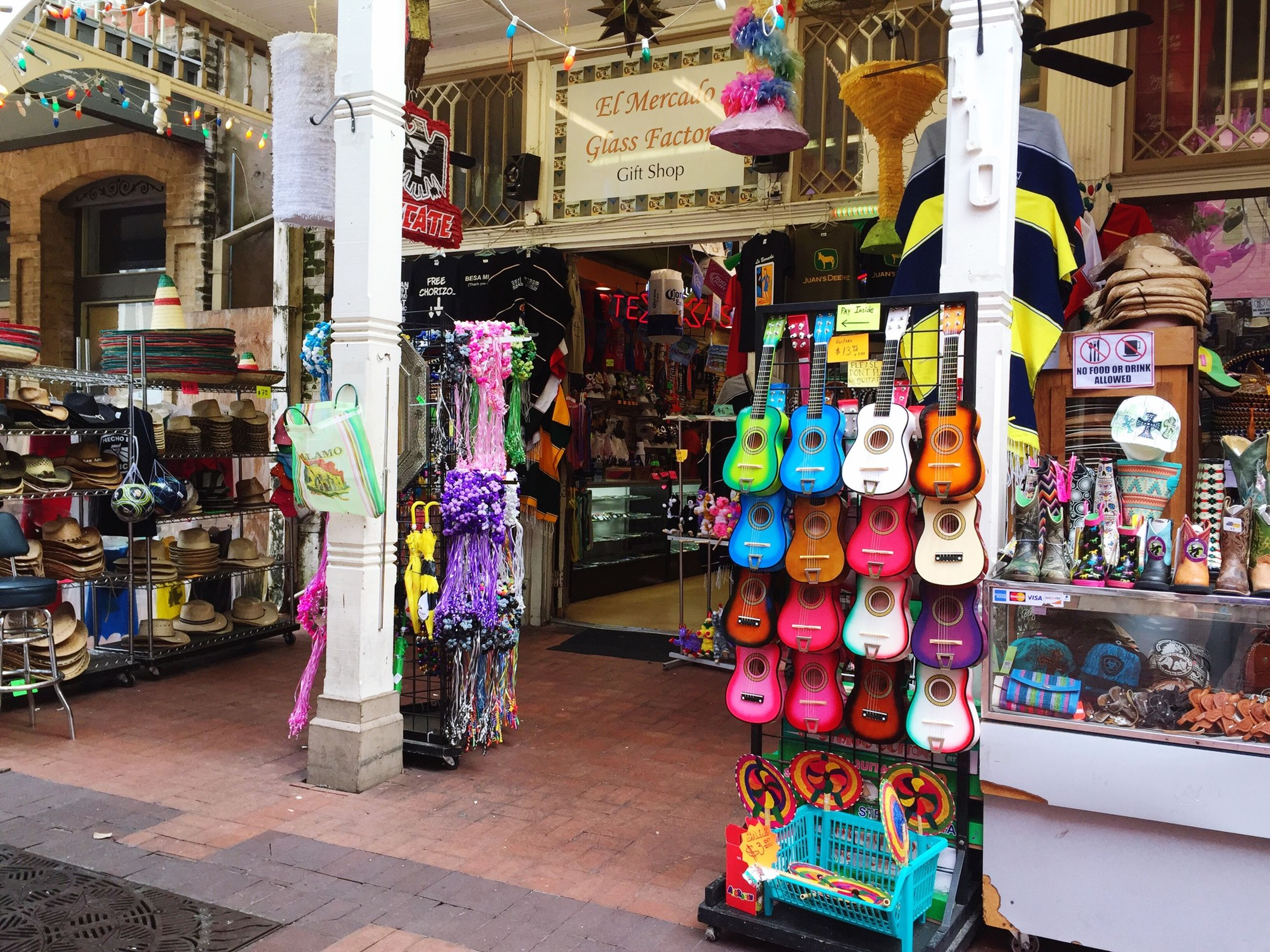 multi colored, variation, choice, retail, for sale, large group of objects, store, market, abundance, market stall, arrangement, building exterior, built structure, collection, shop, hanging, small business, display, architecture, in a row