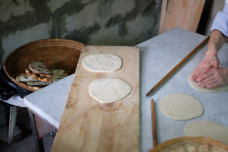Close-up of rolling chapattis