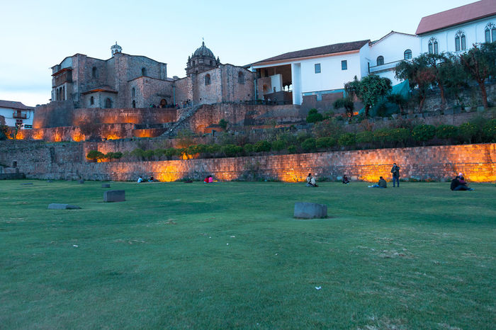 Cusco Coricancha Jardines Religion Religious  Architecture Building Exterior Built Structure Sky Nature Building Grass Fire Day Environment Flame Burning Plant Outdoors Heat - Temperature No People Fire - Natural Phenomenon Land House Residential District Pollution
