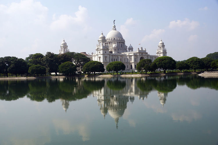 Reflection Building Exterior Architecture Sky Water Travel Destinations Built Structure Travel Tourism Lake Waterfront Tree Nature Plant Dome Day City History No People Government Outdoors Victoria Memorial Kolkata Victoria Memorial Kolkata