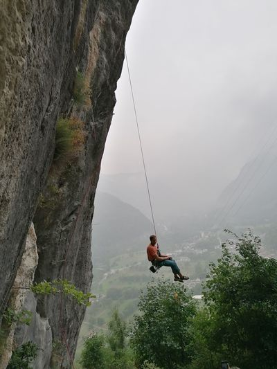 Man on rock against mountains