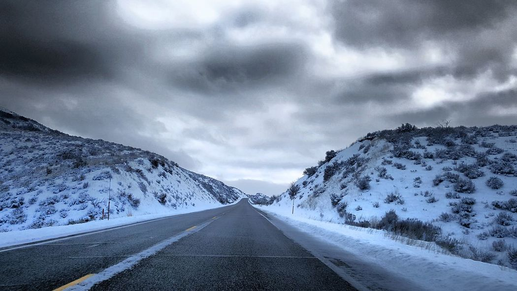 Driving home for the holidays. Idahome Serenity EyeEm Selects Road Dramatic Sky The Way Forward Snow Mountain Landscape Outdoors Winter Storm Cloud Road Trip Nature