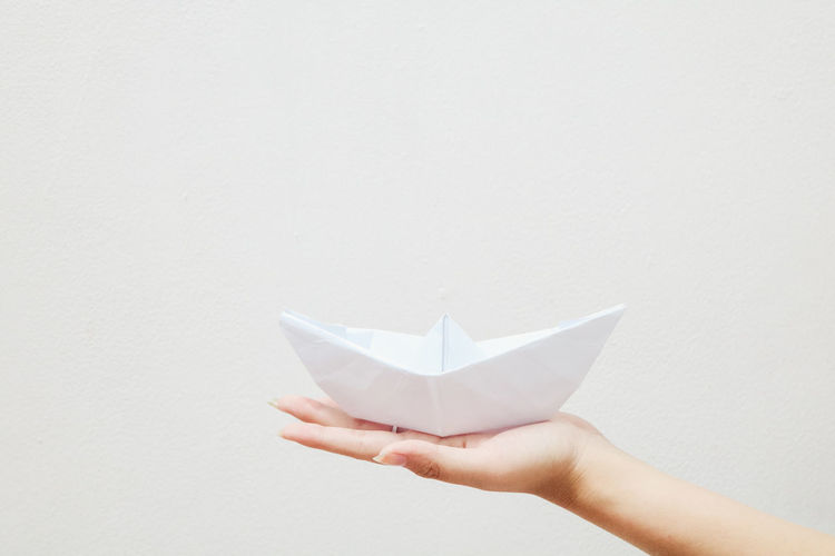 Paper Human Hand Hand Human Body Part Holding One Person Studio Shot White Background Paper Boat Origami Copy Space Creativity Craft Art And Craft Indoors  White Color Folded Close-up Unrecognizable Person Finger Art Lifestyles Hobbies