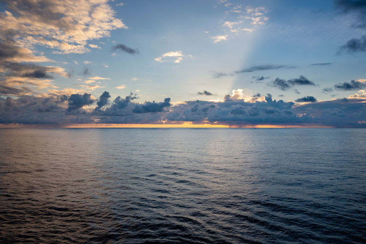 Clouds on horizon 10 Tyndall Tyndall Effect Beauty In Nature Cloud - Sky Clouds Dawn Horizon Horizon Over Water Nature Reflection Rippled Scenics - Nature Sea Sky Sunrise Sunset Tranquility Water Waterfront