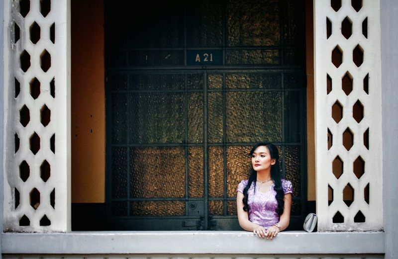 One Person Women Young Adult Portrait Front View Adult Young Women Beauty Beautiful Woman Architecture Looking At Camera Sitting Beautiful People Casual Clothing Waist Up Window Hair Waiting Contemplation Outdoors