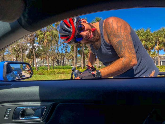 Portrait of man looking through car window