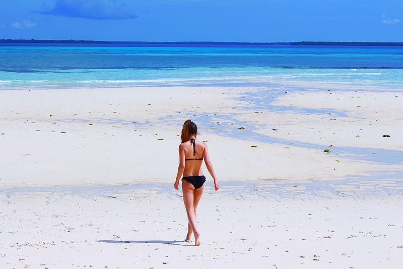 Alone on the island 🌴 Finding New Frontiers EyeEm Selects Premium Collection Zanzibar Tanzania White Sand Blue Water Clear Water Summertime Alone Paradise Beach Paradise Beautiful Beach Sea Sand Rear View Vacations One Person Full Length Bikini Outdoors Young Adult Nature Horizon Over Water Summer Sky Summer Exploratorium