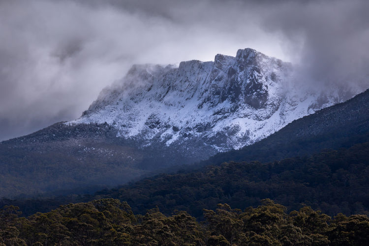 A shot I took in 2016 of the dolerite cliffs on the south end of the Guardian Massif (1394m, 4573 ft) that form an impressive escarpment about 1.5km long. The Guardians are in the Du Cane Range, Lake St Clair National Park, Tasmanian Wilderness World Heritage Area, Tasmania, Australia. Lake St Clair National Park Mountain Scenics - Nature Beauty In Nature Sky Cloud - Sky Environment Mountain Range Nature Non-urban Scene Tranquil Scene Tranquility Landscape Geology Rock Remote Idyllic Outdoors Power In Nature Mountain Peak Snowcapped Mountain Tasmania Wilderness Australian Landscape Guardian Massif Escarpment