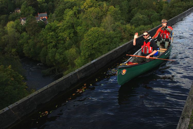 Canoeists on Pontcysyllte aqueduct Aqueduct Canoe Llangollen Canal Pontcysyllte Aqueduct Canal Day Leisure Activity Lifestyles Mode Of Transportation Outdoors River Transportation Water