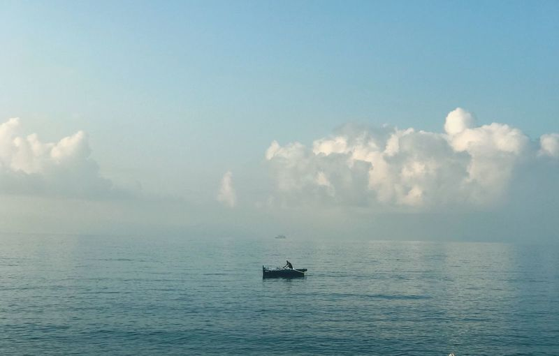 A fisherman alone in Naples Naples, Italy Transportation Water Sea Nautical Vessel Sky Cloud - Sky Adventures In The City