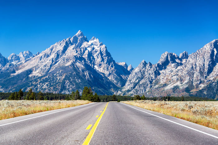 Highway going towards Teton Range in Grand Teton National Park Alpine Bear Jackson Montana National Park Parks Scenic Travel Tundra USA Wanderlust Wyoming Beartooth Destination Forest Grandtetonnationalpark Higway Hole Landscape Lodge Mountain Peaks Range Valley Wilderness