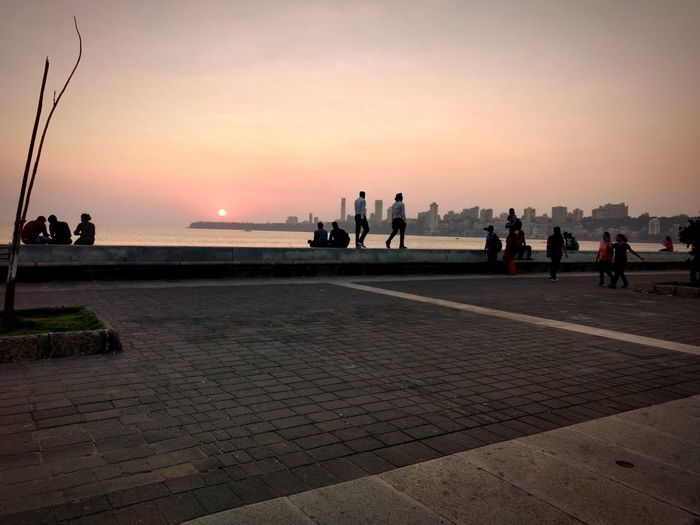 Sunset Tourism Vacations Travel Destinations Silhouette People Water Sea Sky Travel Outdoors Landscape Lifestyles Mumbai Marindrive City Life The Week On EyeEm EyeEm Gallery Photography Photooftheday Eyeemphotography Check This Out EyeEm Best Shots WeekOnEyeEm City Perspectives On Nature