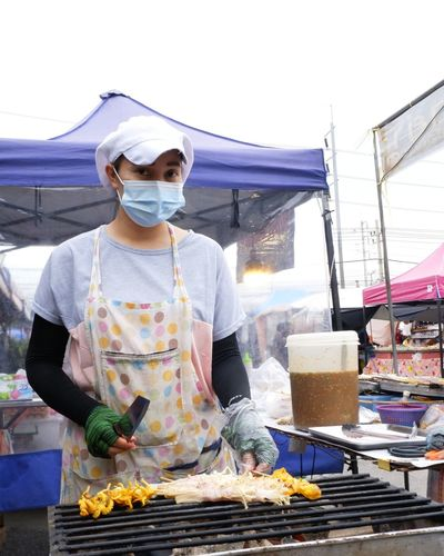 Man holding food at market stall