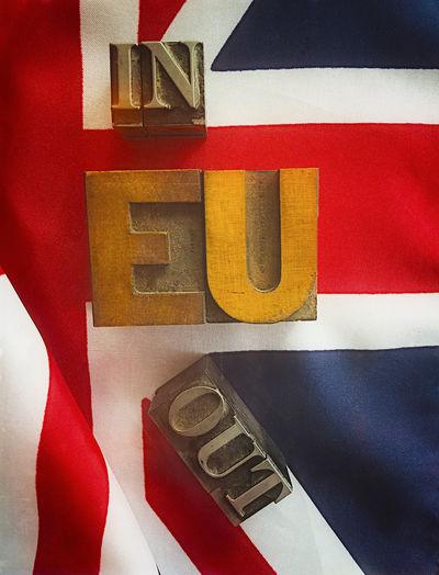 EU in or out on British flag Blue Brexit British Flag Close-up Colorful Cross Current Events Eu Filtered Image Fonts Metal Type News Nobody Phone Camera Red Referendum Textures Type Typography UK Flag Vertical Voting Wood Type