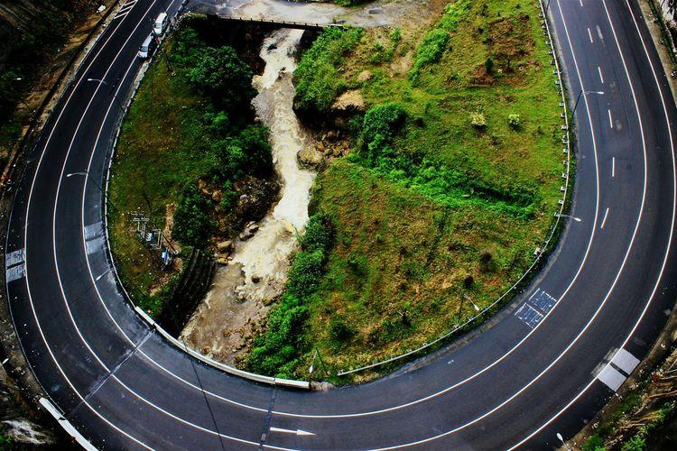 High Angle Shot Of Curved Road Along Landscape