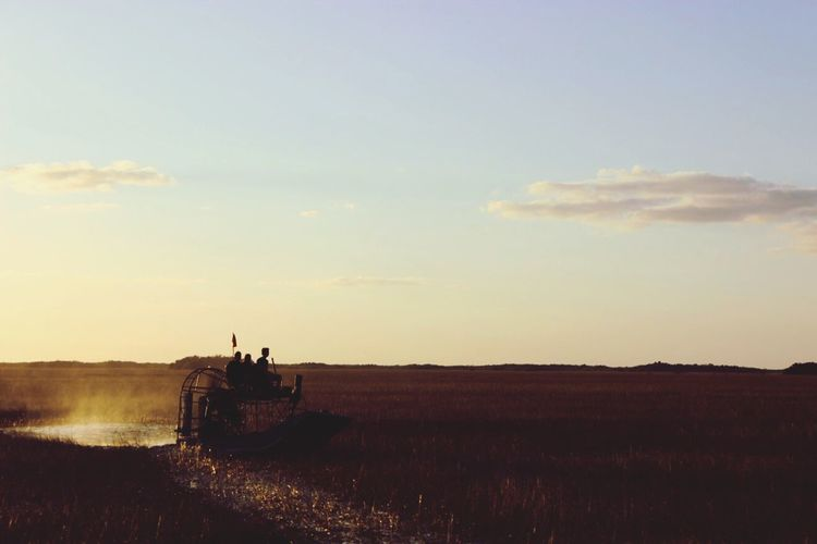 Field Sky Landscape Silhouette Nature Horizon Over Land Outdoors Real People Agriculture Cloud - Sky Rural Scene Airboat Day EyeEmNewHere