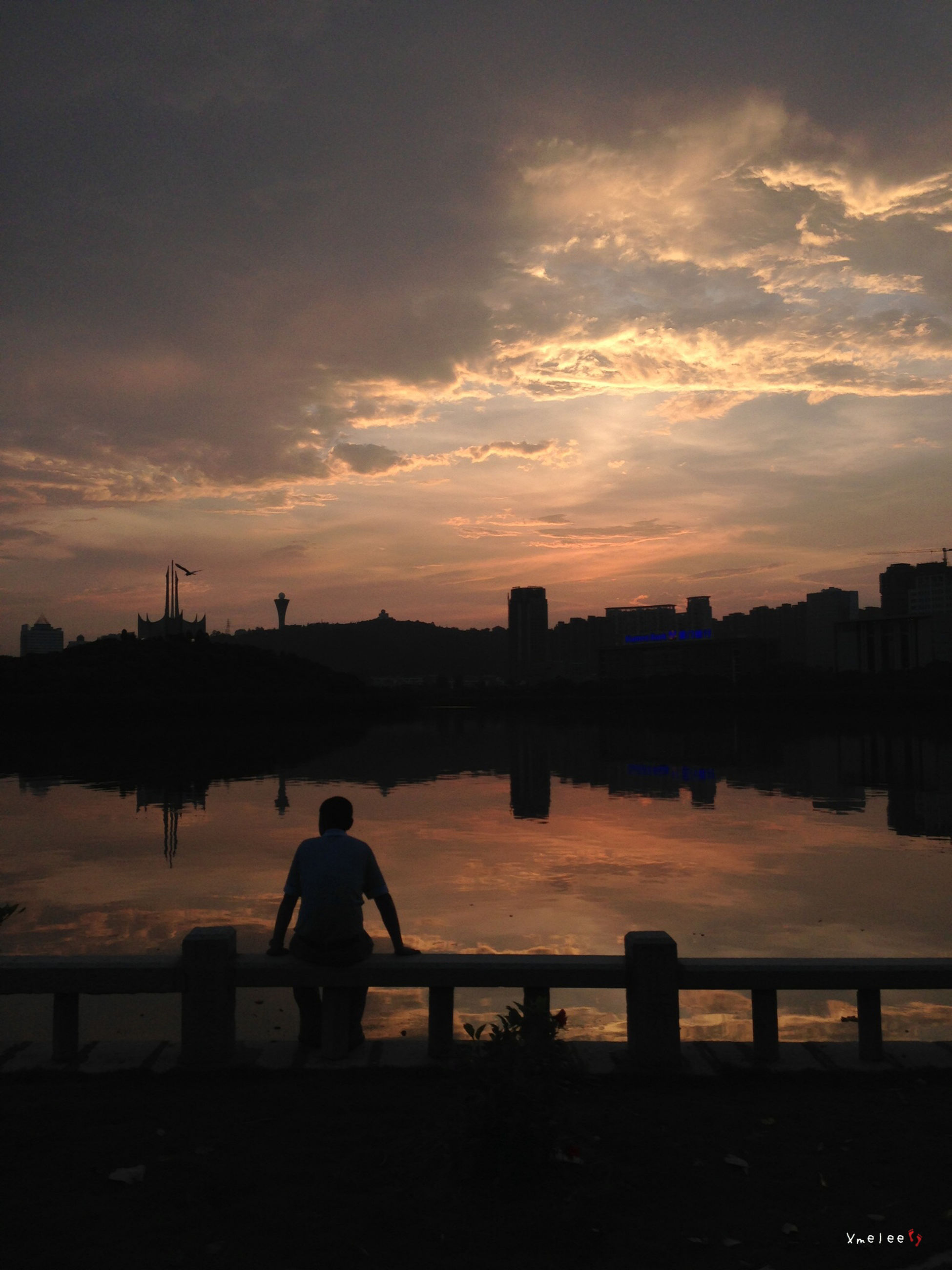 sunset, silhouette, water, sky, men, cloud - sky, lifestyles, lake, standing, river, leisure activity, scenics, tranquility, railing, tranquil scene, beauty in nature, person, built structure