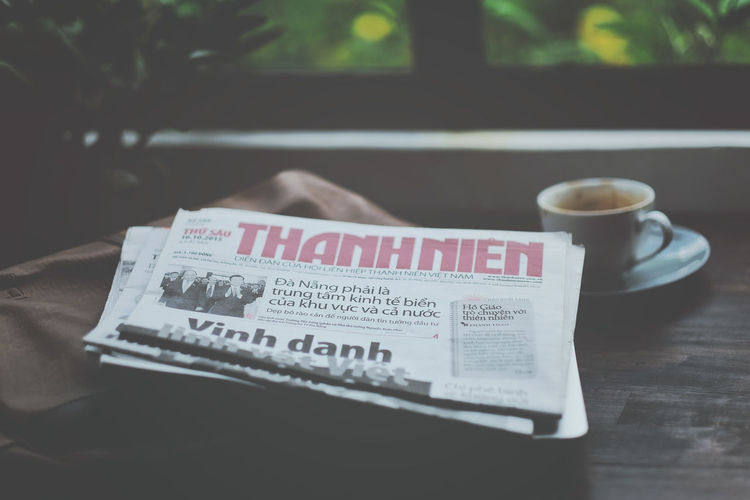 Thanh Nien Newspaper, Vietnamese Daily newspaper. Close-up Coffee Time Daily Newspapers Focus On Foreground Indoors  Newspaper Old Style On The Table Paper Reading Reading & Relaxing Readingtime Text Thanh Nien Newspaper Thành Phố Hồ Chí Minh