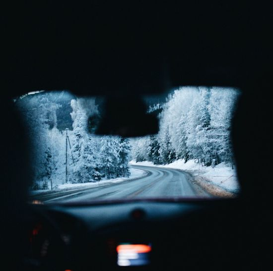 Close-up of car on road during winter