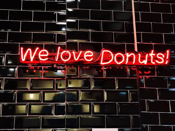 We love donuts We Love Donuts Donuts Text Communication Western Script Sign Illuminated Neon No People Lighting Equipment Information Built Structure Close-up Capital Letter Indoors  Dark Full Frame Red Night Architecture Letter Nightlife