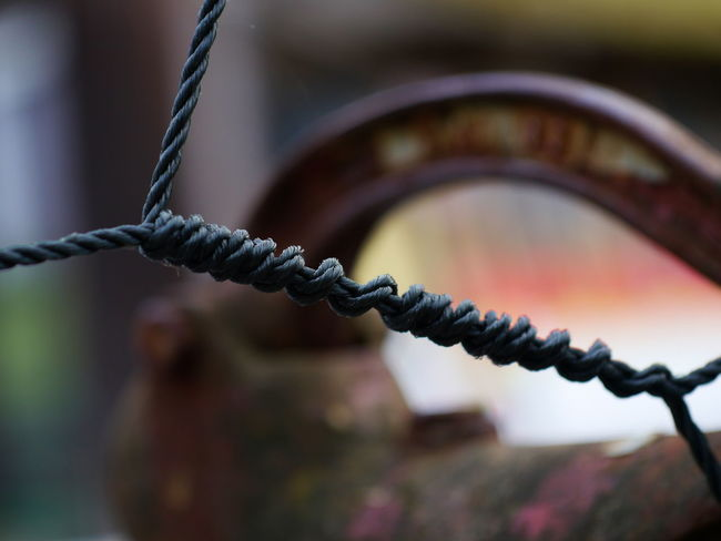 Barrier Boundary Chain Close-up Connection Day Fence Focus On Foreground Germany Landline Phone Metal Nature No People Old Outdoor Outdoor Photography Outdoors Phone Cord Rope Rusty Safety Security Selective Focus Strength Wood - Material