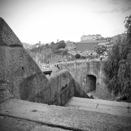 BeW City Cityscape Oporto, Portugal Ancient Civilization Architecture Black And White Building Building Exterior Built Structure Clear Sky Day Environment Fort Fortified Wall History Landscape Monochrome Nature No People Old Outdoors Plant Sky Stone Wall The Past Tree Wall