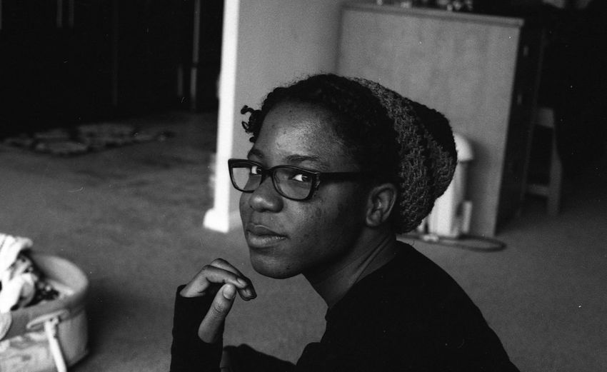 """""""Zaheer"""" by Kesi J. Marcus Close-up Daytime Eyeglasses  Film Photography Focus On Foreground Headshot Indoors  Looking At Camera One Person People Portrait Real People Wireless Technology Young Adult Young Women Art Is Everywhere"""