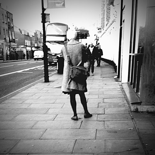 She's on the phone, Streetphotography Hoxton London