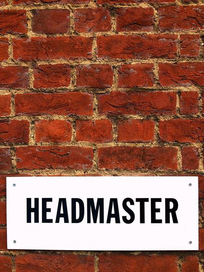 Headmaster Parking Sign On A red Brick Wall With Room For Copy Space. Sutton, England. English Grammar Information Sign Mortar Texture Red Orange Cooy Space England Sutton School Headmaster Sign Brick Wall Bricks Text Western Script Brick Wall Communication Wall - Building Feature Capital Letter Red Close-up Built Structure Architecture Guidance Outdoors No People Day
