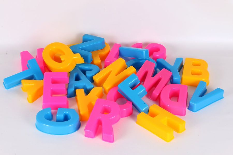 colorful alphabetic letters in the studio ABC Alphabet Pink Alphabet Alphabetical Beachtoys Blue Close-up Colorful Day Heap Indoors  Letter Lot Many Multi Colored No People Pile Plastic Sand Mold Sand Mould Studio Shot Toy White Background Yellow