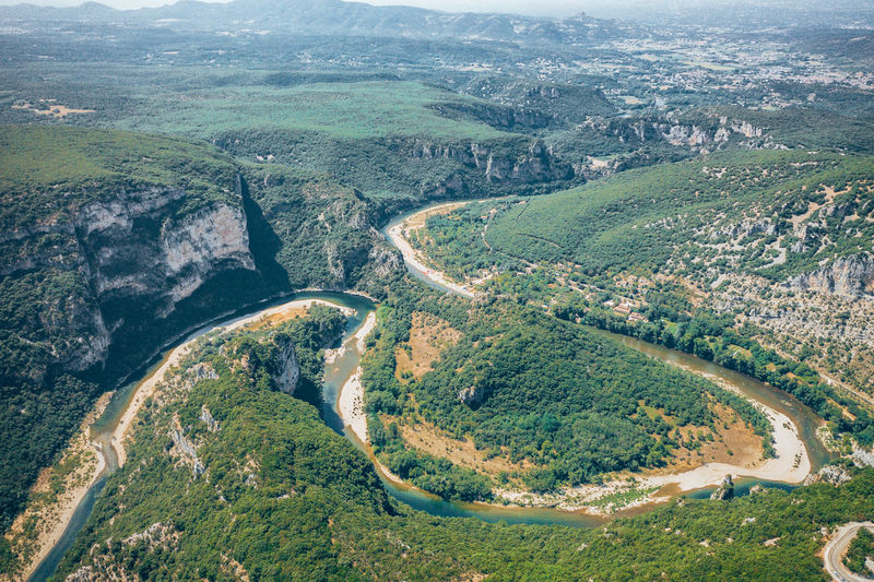 Aerial view of river flowing on landscape