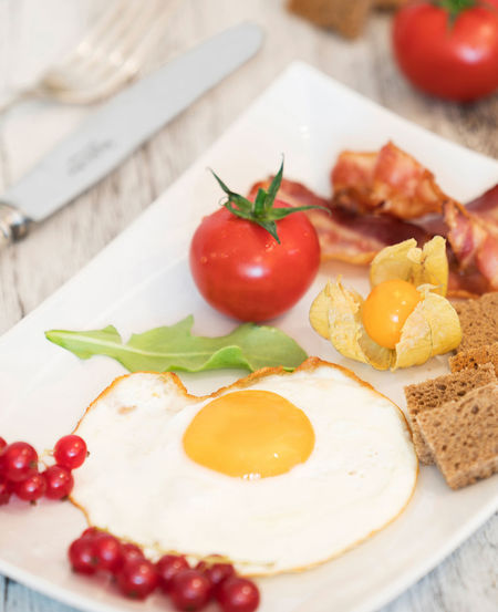 Fried Egg with bacon Red Arranges Bacon Bread Breakfast Close-up Cranberries Egg Food Food And Drink Food Still Life Freshness Fried Healthy Eating Indoors  Meat No People Plate Ready-to-eat Table Tomato Tomatoes White Wood - Material Yellow