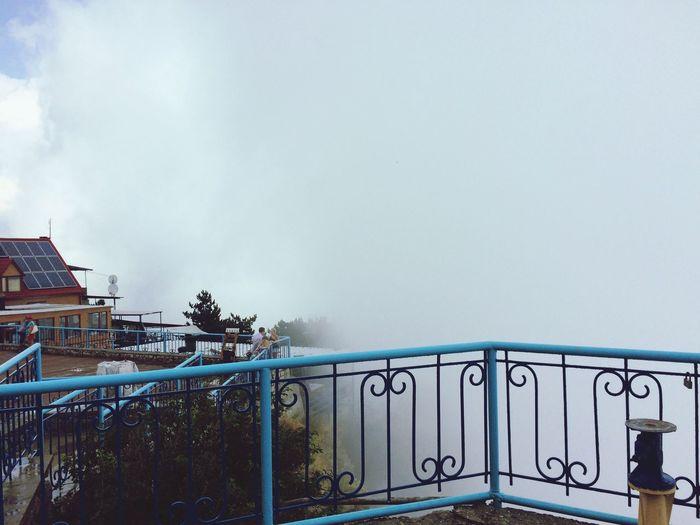 Railing against clear sky