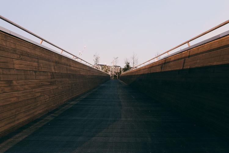 View of narrow pathway along walls