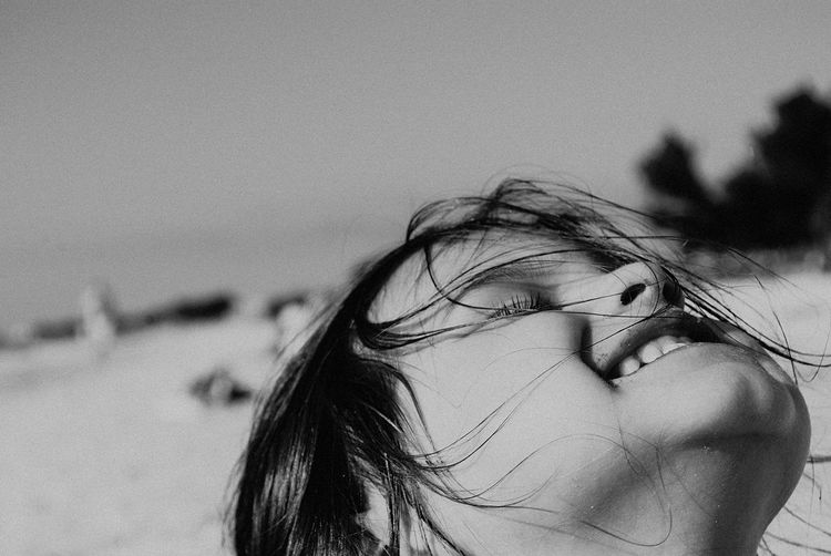 Focus On Foreground One Person Beach Human Hair Wind Sand Sea Real People Outdoors Human Body Part Nature Water Close-up Day Sky EyeEmNewHere
