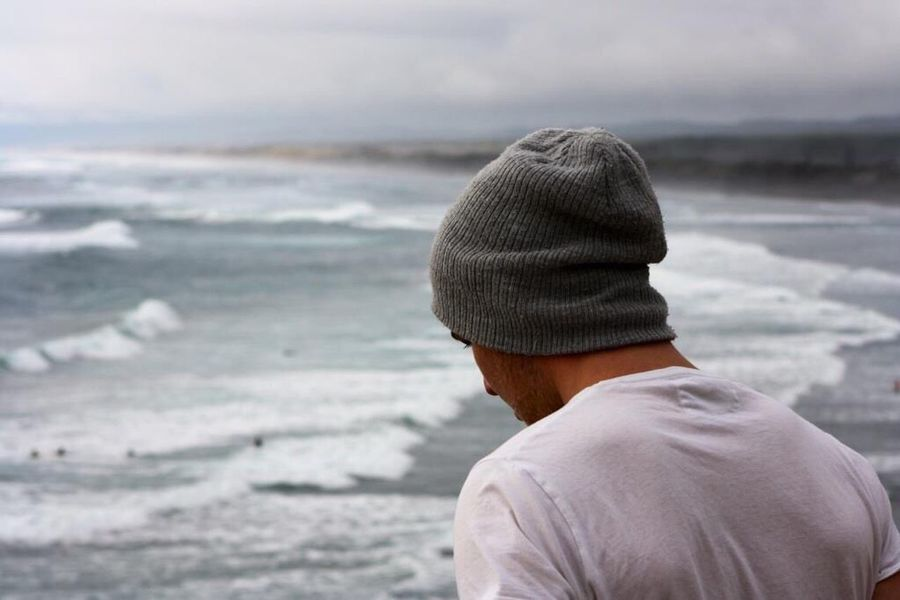 Contemplation... Surf Person Outdoors Blue Wave Adventure Sea And Sky Ocean Waves Beach Surfer Portrait Candid Portraits Candid Photography Muriwai Beach Remote Blue Grey Telling Stories Differently