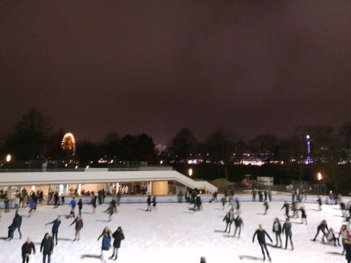 Winter Cold Temperature Snow Winter Sport Ice Rink Large Group Of People Night Ice-skating Ice Hockey Hockey Ice Christmas Illuminated Frozen Skating People Outdoors Christmas Decoration Crowd Warm Clothing Dom
