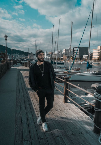 // shooting with Pedro // EyeEm My Best Photo portrait of a friend Portugal Looking At Camera One Person Sky Portrait Real People Cloud - Sky Young Adult Full Length Water Front View Lifestyles Nautical Vessel Transportation Young Men Architecture Leisure Activity Day Standing Pier Harbor Outdoors