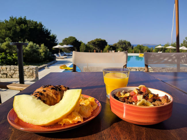 Breakfast Close-up Day Delicious Food Food And Drink Freshness Freshness Fruit Healthy Eating Island Life Melon No People Orange Juice  Outdoors Plate Poolside Ready-to-eat Resort Sky SLICE Table Vacay