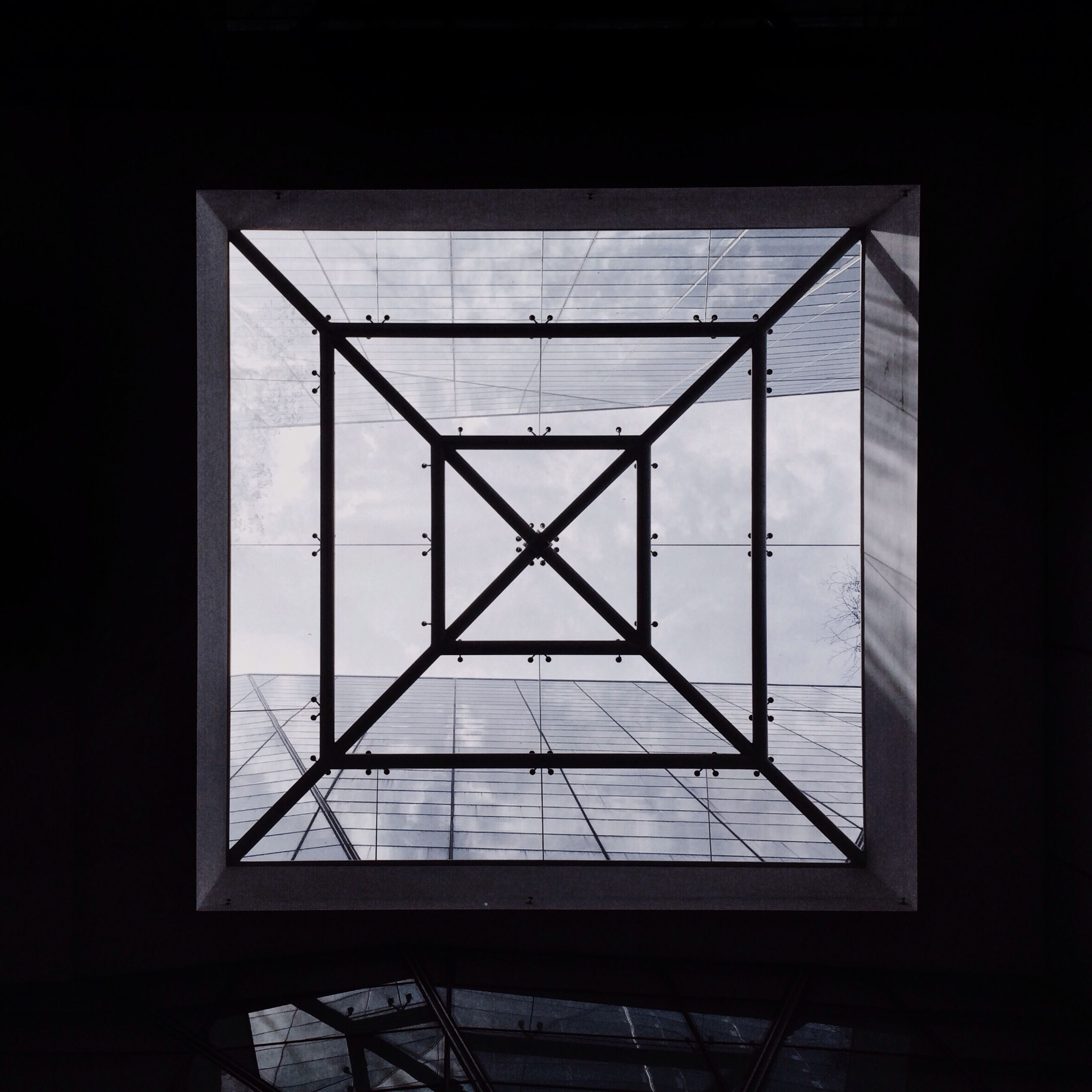 indoors, window, glass - material, built structure, architecture, transparent, geometric shape, low angle view, glass, no people, day, sky, copy space, home interior, sunlight, ceiling, skylight, pattern, modern, clear sky