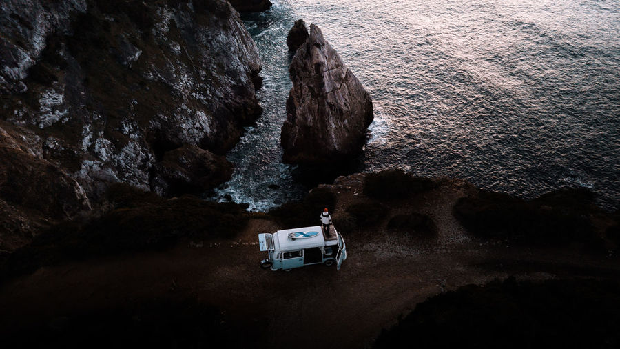 High angle view of man standing on caravan at beach