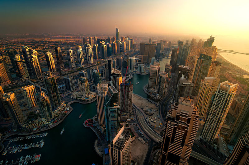 Amazing colorful dubai marina skyline during sunset. Great perspective of multiple tallest skyscrapers of the world. Direct sunlight over buildings. Dubai marina, United Arab Emirates. Dubai Dubai Marina United Arab Emirates Aerial Architecture Building Building Exterior Built Structure City Cityscape Financial District  High Angle View Modern Nature No People Office Office Building Exterior Outdoors Sky Skyscraper Sunset Tall - High Tower Travel Destinations Water