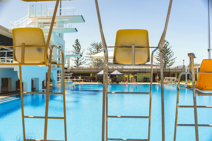 poolside at the Gold Coast Aquatic Centre 2018 Commonwealth Games venue Aquatic Centre Clear Sky Day Diving Platform No People Outdoors Seat Seating Sky Swimming Pool Water Water Park Water Slide Yellow