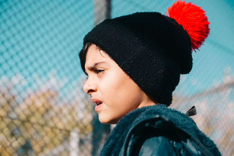 Portrait of little boy wearing warm clothing