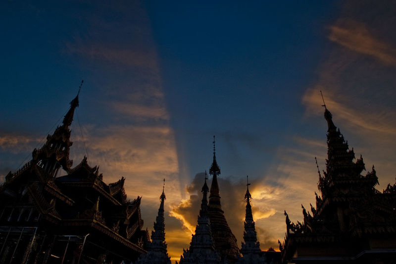Low angle view of temple against sky during sunset