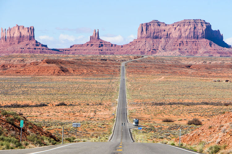 Landscape Transportation Mountain Non-urban Scene Environment Rock Scenics - Nature Rock Formation Rock - Object Nature Sky Beauty In Nature Day Road Solid Tranquil Scene Geology Physical Geography No People Mountain Range Formation Outdoors Climate Eroded Arid Climate Monument Valley