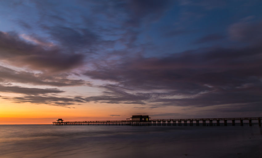 Naples Naples Pier Beach Beauty In Nature Built Structure Cloud - Sky Florida Golden Hour Nature Outdoors Scenics Sea Sky Sunset Tranquility Water