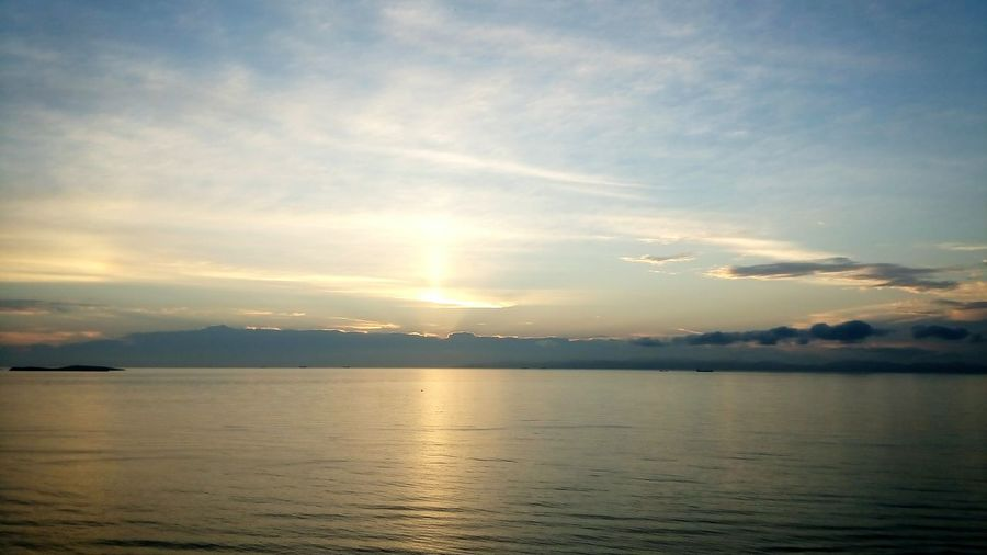 Sunset Scenics Sea Cloud - Sky Outdoors Beauty In Nature Dramatic Sky Horizon Over Water Water Tranquility Nature Reflection No People Sky Landscape Sunlight Tranquil Scene Sun Beach Vacations Nature