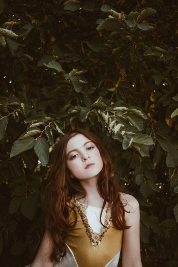 Girl of the Garden Portrait Of A Woman Young Beautiful Woman Branch Close-up Day Fashion Femininity Flower Garden Garden Photography Girl Growth Leaf Long Hair Nature One Person Outdoors Portrait Real People Standing Tree Young Adult Young Women